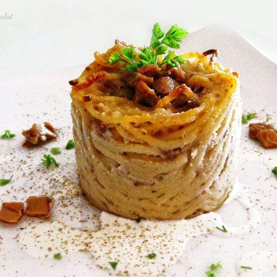 foto Sformatini di spaghetti di Gragnano con salsiccia e porcini